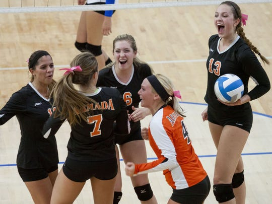 Armada volleyball players celebrate a win over BWAC rival Cros-Lex.