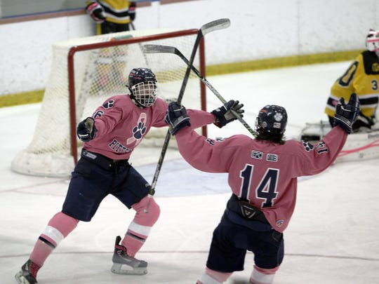 Pittsford's uniforms turn pink Saturday for its game against Fairport at Rochester Institute of Technology's Ritter Arena.