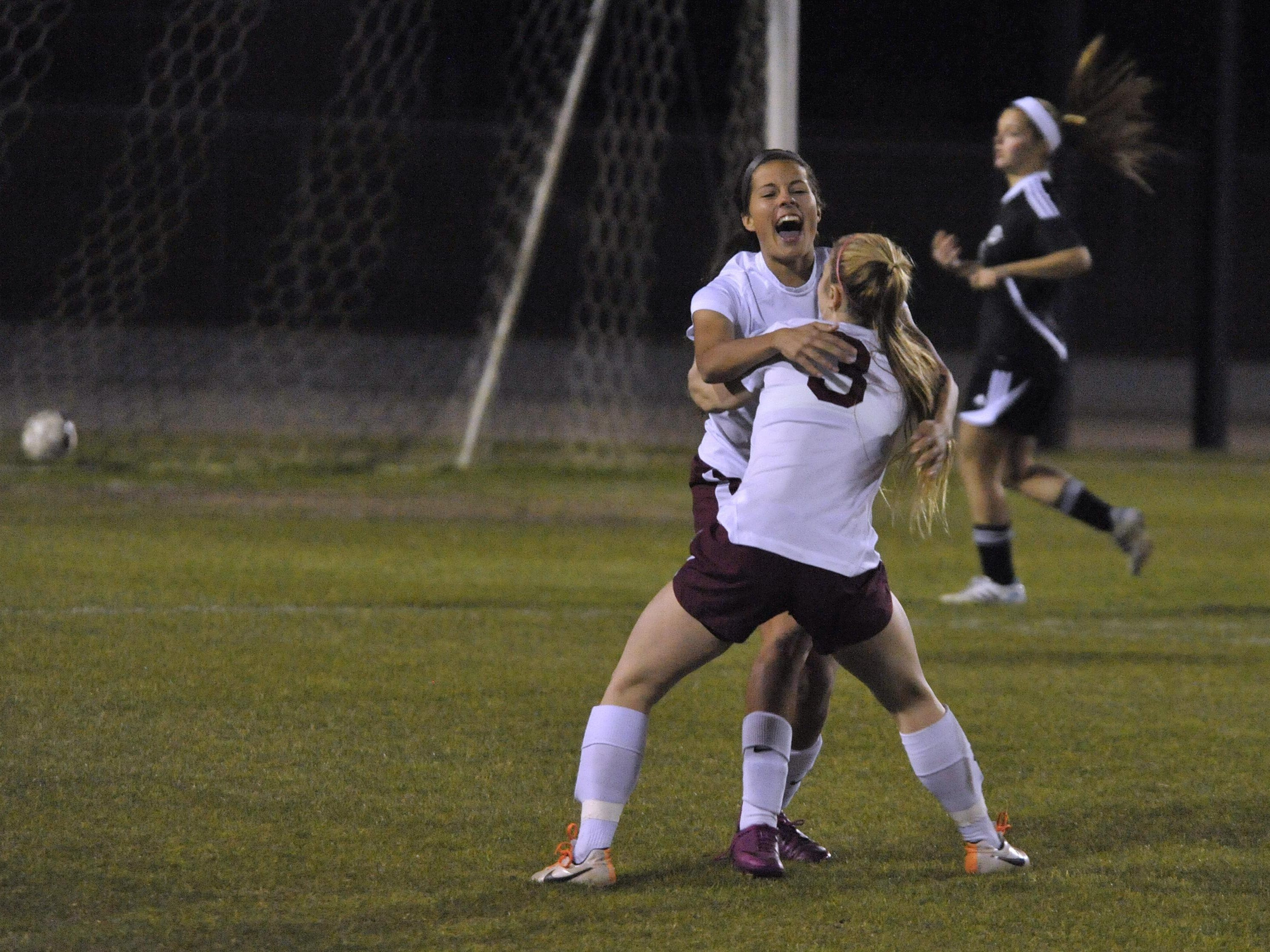 Emily Madril of Navarre celebrates with teammate Kayla Folse, front, after Madril scored the first goal against Creekside during their Region 1-4A title game at Navarre in 2015. On Tuesday, Madril was named Class 4A state player of the year.