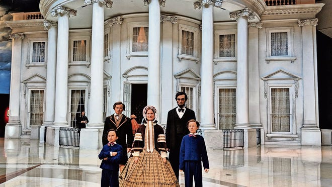 Pose for a photo with President Lincoln and his family outside the White House exhibit.