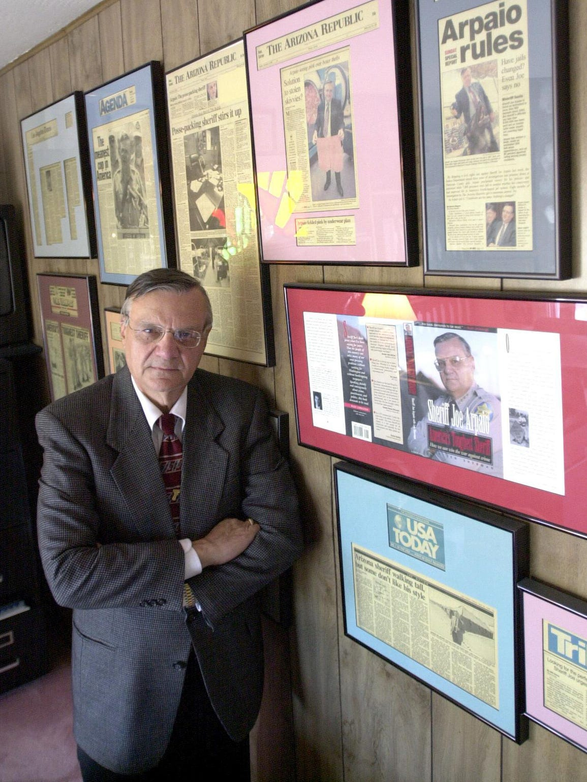 Arpaio poses in his home office in 2001, during his
