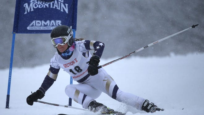 GiGi Vasile of Webster races to a second-place finish in the giant slalom. She won the slalom, as well as the overall title, at the Section V skiing championships at Bristol Mountain.