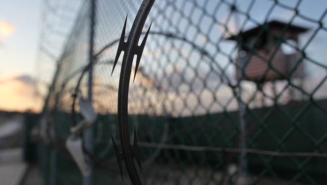 In this May 13, 2009 file photo reviewed by the U.S. military, the sun rises over the Guantanamo detention facility at dawn, at the Guantanamo Bay U.S. Naval Base, Cuba.  U.S. military officials at the prison announced Monday that they will stop releasing daily hunger strike updates because the numbers of protesting inmates has steadily dropped.