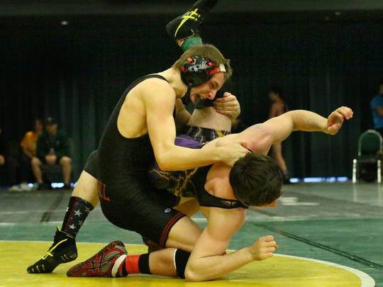 Foothill High's Russell Rucklos, left, wrestles Modoc's Zach Norby in the 154-pound final Saturday night at the Northern Section Masters wrestling championships at the Redding Civic Auditorium. Rucklos pinned Norby.