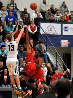 Jaelan Sanford (13 in white) is Evansville Reitz's leading scorer.