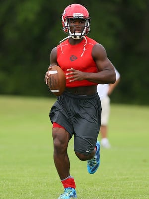 Clinton quarterback Cam Akers searches for an open receiver in the Medicomp 7 on 7 tournament in Madison.