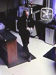 A still photo from surveillance video shows former judge David Loughry walking around the metal detector in the foyer Saturday, Oct. 31 at the Rutherford County Judicial Building.