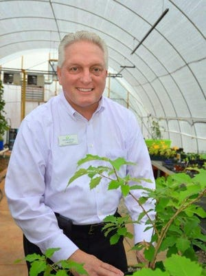 Craig Byrd, director of development and marketing at Thrive Upstate, stands in the organization's greenhouse which employs and trains individuals with disabilities.