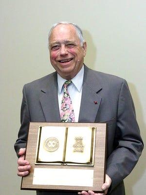 Dr. John Roush received the Book of Golden Deeds award.