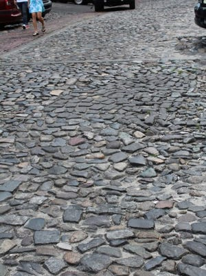 Cobble stones left behind by ships from abroad can be seen today in the paved surface of Savannah Georgia's River Street.
