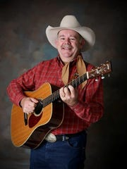 Gary Cook has been with the Bar D Wranglers for more than 25 years, now serving as lead guitarist and band leader.