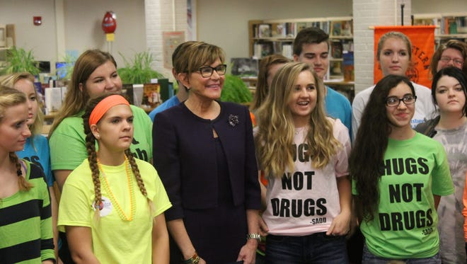 In this file photo, state Department of Health Secretary Dr. Karen Murphy visits Northeastern High School in 2016 to announce the department's distribution of naloxone, a medication used to block the effects of opioids like heroin and prescription pain medicine, to 128 public schools.