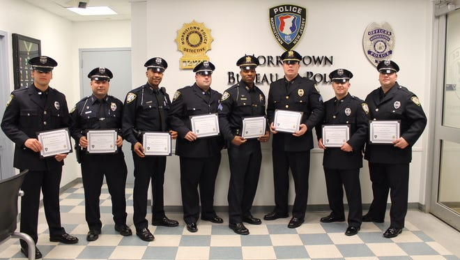 Morristown Officers honored for service during a Pine Street fire in July 2015 are, from left: Bryan Holmes, Richard Rispoli, Yeison De Los Santos, Christopher Little, Sgt. Tyrone Jackson, Sgt. Brian LaBarre, Officer Michael Alberto, Officer Mark Underhill.
