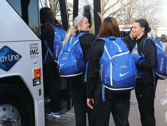 MTSU Women's Team Rebecca Reuter, left, waves good-bye