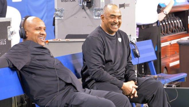 Cincinnati Bengals offensive coordinator Hue Jackson and head coach Marvin Lewis watch on.