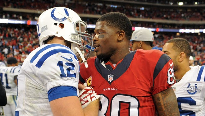 FILE -- Andrew Luck and Andre Johnson talk after a Nov. 4, 2013 game.
