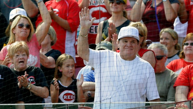 Former Cincinnati Reds great Pete Rose acknowledges the crowd during a baseball game Sept. 28, 2014, in Cincinnati.