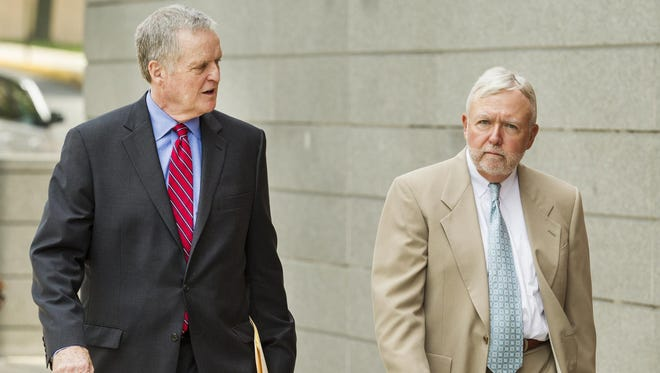 Former Delaware Chief Medical Examiner Richard T. Callery (right) and his attorney Dan Lyons walk Thursday into the New Castle County Courthouse, where Callery pleaded no contest to two counts of official misconduct.
