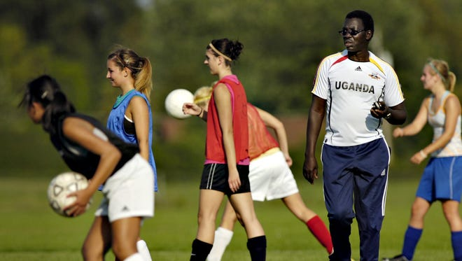 Then Apollo soccer coach Ganard Orionzi works with the school's girls team in this file photo from 2010.