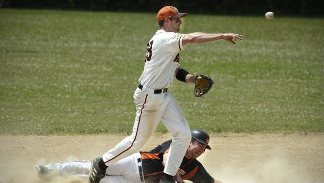 St. Wendel 's Lee Maciej makes the double play from second to first after putting out St. Stephen's Ben Omann at second during the fourth inning Sunday in St. Stephen.
