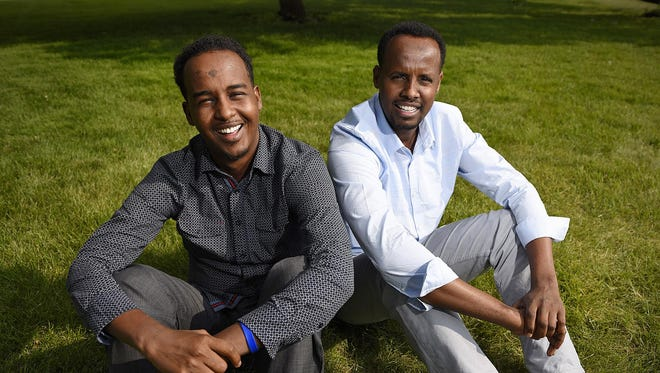 Hussein Mohamud, 25, and Feisal Ali, 30, grew up together in Dadaab refugee camp in Keyna. Now they are back together both living in St. Cloud.