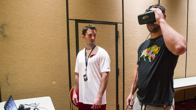 Arizona Cardinals quarterback Drew Stanton tests the new virtual reality system to train quarterbacks with Colin Clancy (left) on Tuesday, August 4, 2015.
