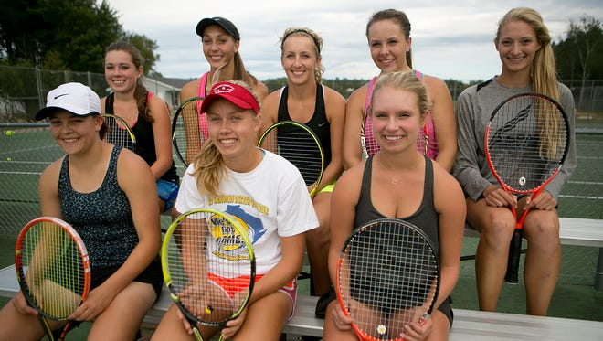 The SPASH girls varsity tennis team poses during practice at Stevens Point Area Senior HIgh School, Wednesday, Sept. 9, 2015. From left, front row, Kaylee Boureau, Emily Luetschwager, and Lily Firkus. From left, back row, Jaide Barber, Emily Meyer, Juliet Champion, Suzy DeBot, and Kayla Stutesman.