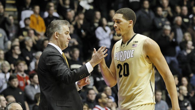 Matt Painter and A.J. Hammons exchange a high five as the seven-foot center comes out against Indiana, Jan. 28, 2015.
