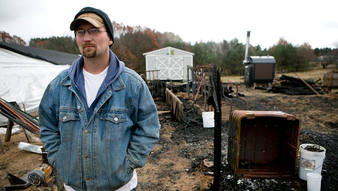 Tim Cisewski of Custer stands where his barn used to be, Thursday, Oct. 29, 2015. A fire burnt down the barn on Oct. 19 and killed the family's bull named Francis.