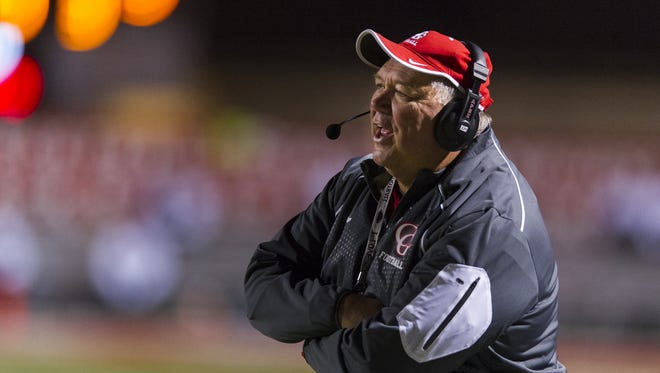 Center Grove coach Eric Moore has been loyal to his Wing-T offense.
