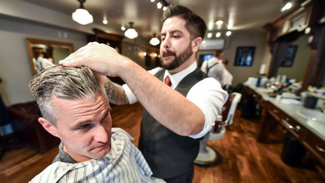 Don Duncan gets his hair cut by Vinnie Gravallese, owner of Derby Supply Co. Derby Supply Co is a man's hair cutting shop designed to feel like a 1920s barber.