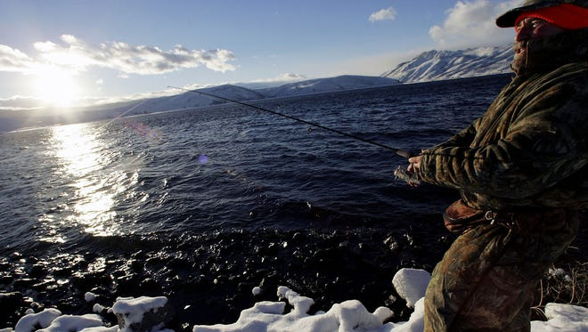 Hugh Fonzo, of Dayton, Nev., casts his line on the opening day for fishing at Topaz Lake Saturday, Jan. 1, 2005, at Topaz Lake, Nev. (AP Photo/Nevada Appeal, Brad Horn)