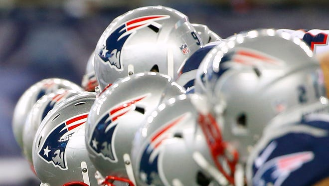 New England Patriots helmets are seen at the line of scrimmage Dec. 6, 2015.