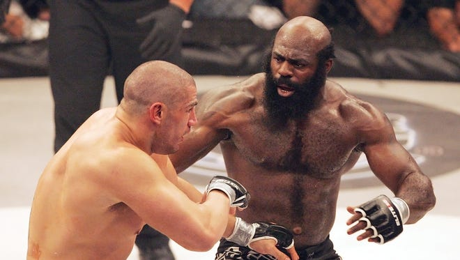 This May 31, 2008, file photo shows Kimbo Slice, right, battling James Thompson of Manchester, England during their EliteXC heavyweight bout at the Prudential Center in Newark, N.J.  Police in Florida say Slice had been taken to a hospital, though the reason why wasn't immediately clear.