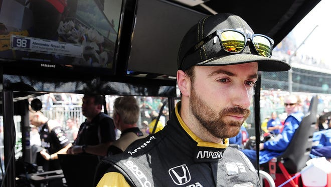 IndyCar driver James Hinchcliffe (5) has a stunned look on his face after a disappointing finish in the 100th running of the Indianapolis 500 Sunday at the Indianapolis Motor Speedway.