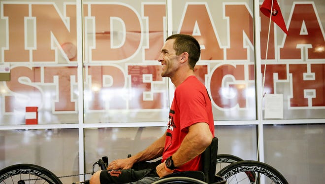 Tom Morris, the assistant athletic director for strength and conditioning and performance at Indiana University, speaks with a soccer player after a short workout on July 22, in preparation for the Maytag Ironman 70.3 Steelhead in Benton Harbor, Michigan on August 14, 2016.