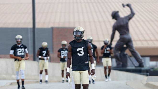 """Bilal Marshall and his teammates walk to football practice Thursday, August 4, 2016, at Purdue University. """"It's a great day to be a Boilermaker,"""" said Marshall."""