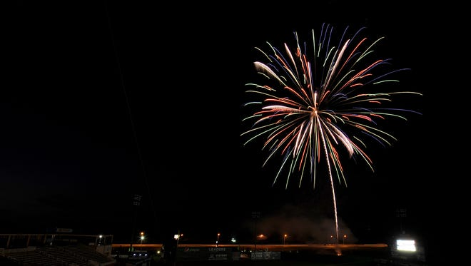 Fireworks explode in the sky over The Ballpark at Jackson.