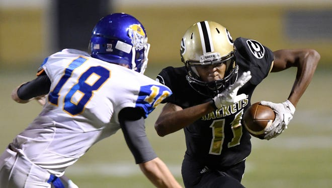 Greer's Richie Sadler (11) tries to get around Travelers Rest's Mitchell Blackwell (18) Friday night at Dooley Field.