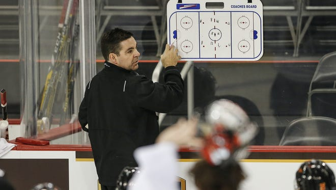 New Indy Fuel head coach Bernie John draws up drills on a whiteboard during practice at the Indiana Farmers Coliseum at the Indiana State Fairgrounds on Oct. 12, 2016.