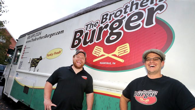 The burger brothers (L to R) Cole and Jeremiah James next to The Brothers Burger food truck on Tuesday, Nov. 8, 2016.