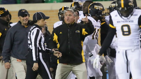 Southern Miss coach Jay Hopson questions a call against his team at Apogee Stadium.