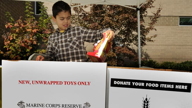 Juan Garcia, 9, checks out toys donated for Toys for Tots.