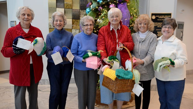 Ladies of the Yarn, Dot Simpson, Grace Heaberg, Betty Thomas, Evelyn Sutton, Peggy Sheffield, and Elaine Jones, presented knitted hats to the Kirkland Cancer Center on Wednesday.