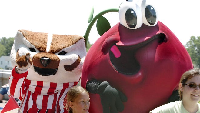The Cranberry Guy hangs out with Bucky Badger at a parade in Wisconsin Rapids.