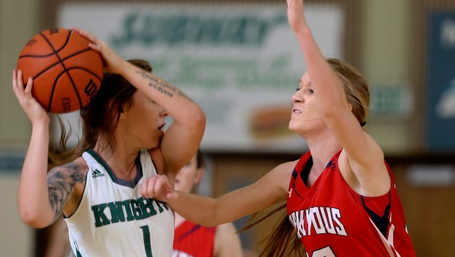 Shasta College's Kilee Hannan looks to pass the ball past College of the Siskiyou's Hannah Thompson in the Knights' 73-54 loss Wednesday night.