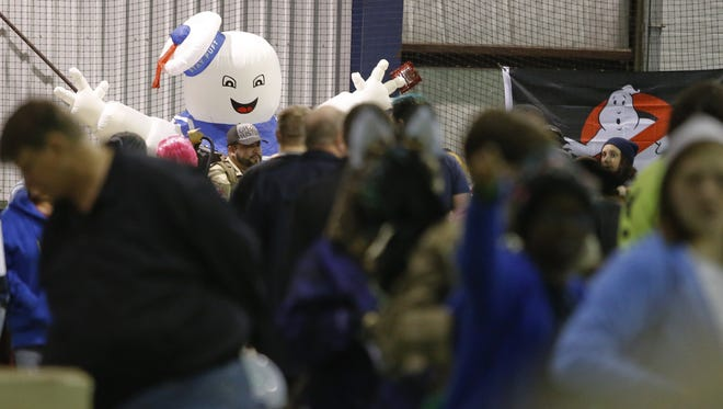 The Stay Puft Marshmallow Man looks over attendees during the Galactic Con in Middletown.