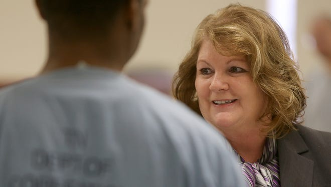 Sherrie Hughey, an employment specialist with the Tennessee Department of Correction, speaks with inmates during a job fair at the Hardeman County Correctional Facility in Whiteville on Thursday, March 23, 2017.