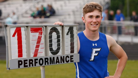 Colton Crum of Frankfort celebrates after clearing