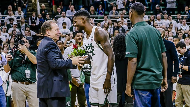 MSU men's basketball coach Tom Izzo, left, shakes hands with senior Eron Harris during Senior Day celebrations after the Spartans' game with Wisconsin Sunday February 26, 2017 in East Lansing.